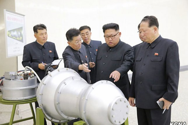 A North Korean image of Kim Jong Un (C) examining a nuclear warhead in 2017. The regime has continued to miniaturize weapons, according to a South Korean press report. File Photo by Stephen Shaver/UPI