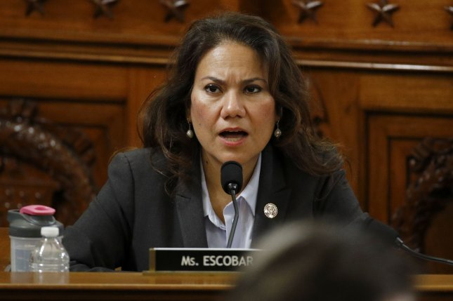 Rep. Veronica Escobar, D-Texas, votes to approve the first article of impeachment against President Donald Trump during a House judiciary committee meeting, on December 13. File Pool Photo by Patrick Semansky/UPI
