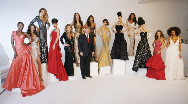 Donald Trump is joined by past Miss Universe winners for a photo session at Chelsea Piers on July 27, 2011 in New York City. The beauty queens and real estate mogul are gathered to be photographed by pageant photographer Fadil Berisha. UPI/Monika Graff.