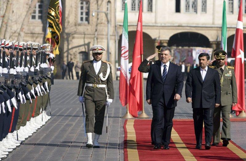 Iranian President Mahmoud Ahmadinejad welcomes Turkish President Abdullah Gul during an official welcome ceremony in Tehran, Iran on February 14, 2011. UPI/Maryam Rahmanian