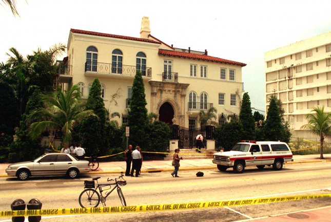 Investigators process the crime scene on July 17 at Gianni Versace's manion on South Beach, in Miami Beach, Fla., where Versace was shot and killed on July 15, 1997. FX has renewed American Crime Story for a third season, which will focus on the murder of Gianni Versace. File Photo by Adam Werner/UPI