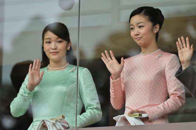 Japan's Princess Mako (L) and sister Princess Kako wave to well-wishers in Tokyo on January 2, 2015. File Photo by Keizo Mori/UPI