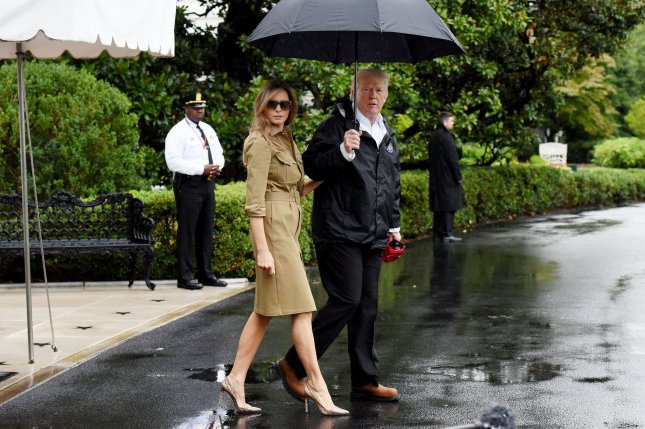 U.S. President Donald Trump walks with first lady Melania Trump prior to their Marine One departure from the White House in Washington, D.C., Sept. 2, 2017. The President and first lady are traveling to Texas and Louisiana to visit Hurricane Harvey relief centers in both states. Photo by Olivier Douliery/UPI