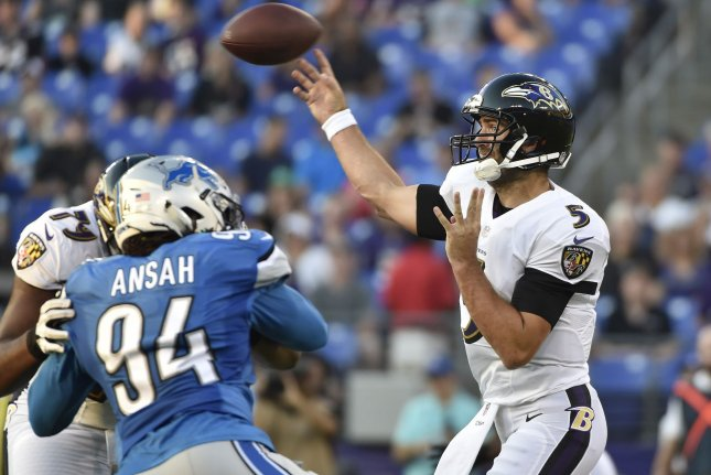 Baltimore Ravens quarterback Joe Flacco (5) throws under pressure from Detroit Lions defensive end Ezekiel Ansah (94) during the first half of their NFL preseason game on August 27, 2016 at M&T Bank Stadium in Baltimore, Maryland. File photo by David Tulis/UPI