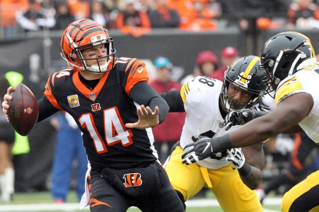Cincinnati Bengals quarterback Andy Dalton (14) throws under pressure from the Pittsburgh Steelers' defense during the first half of play on October 14, 2018 at Paul Brown Stadium in Cincinnati, Ohio. Photo by John Sommers II/UPI