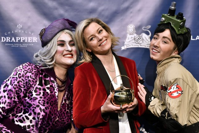 Actress Elizabeth Banks attends a press conference with Hasty Pudding Theatricals cast members, Eric Cheng (L) and Celia Kenney on Friday. Photo by Joshua Reynolds/UPI