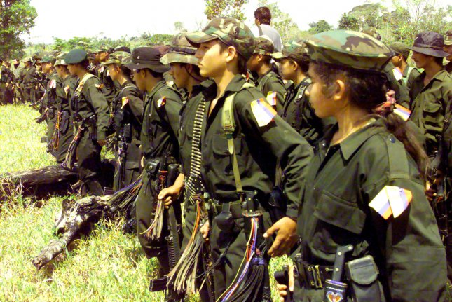 A group of guerrilla members attend the Los Pozos Peace Talks meeting between the FARC rebel group and the Colombian government in 1999. Wednesday, the rebel group and the Colombian government agreed to a peace accord that will bring an end to 52 years of armed conflict -- the longest-running conflict in the Western Hemisphere. File Photo by Rafa Salafranca/UPI