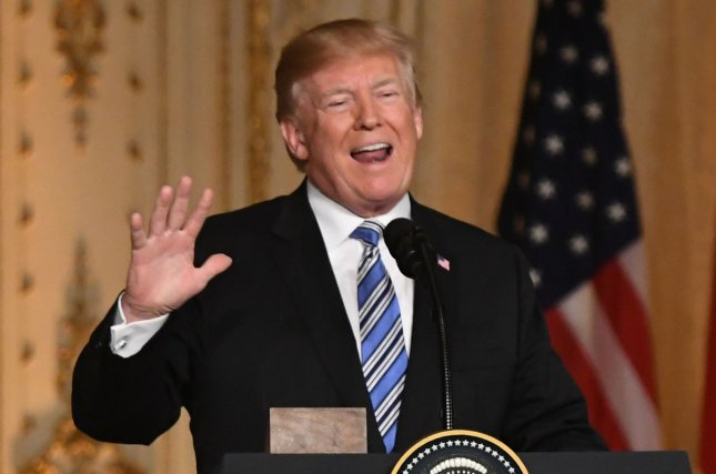 President Donald Trump reasserted his commitment to eliminating unnecessary and harmful regulations and promoting a a strong, market-driven economy to protect the environment on Earth Day. Photo by Gary I Rothstein/UPI