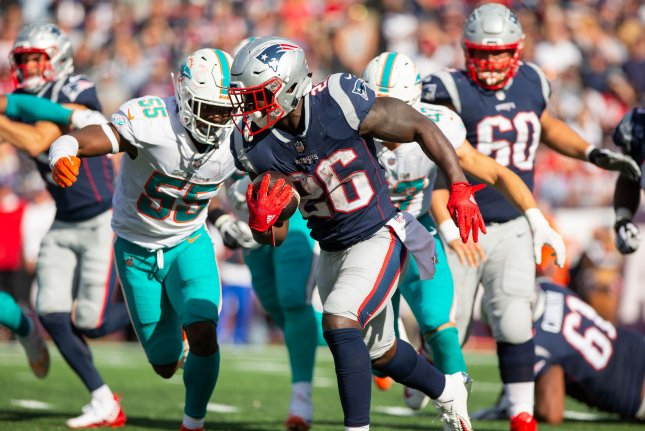 New England Patriots running back Sony Michel (26) is chased by Miami Dolphins linebacker Jerome Baker (55) on a carry in the third quarter on Sunday at Gillette Stadium in Foxborough, Massachusetts. Photo by Matthew Healey/UPI