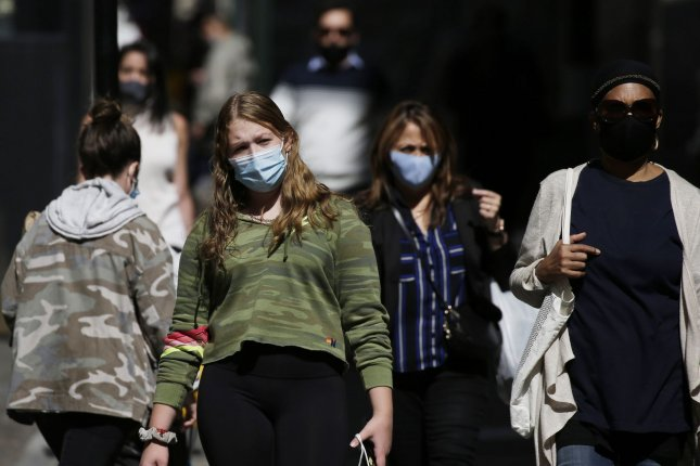 The CDC reports that young adults represent more new coronavirus cases in the United States than other age groups. Pictured, pedestrians wear face masks while walking in Lower Manhattan in New York City on Monday. Photo by John Angelillo/UPI