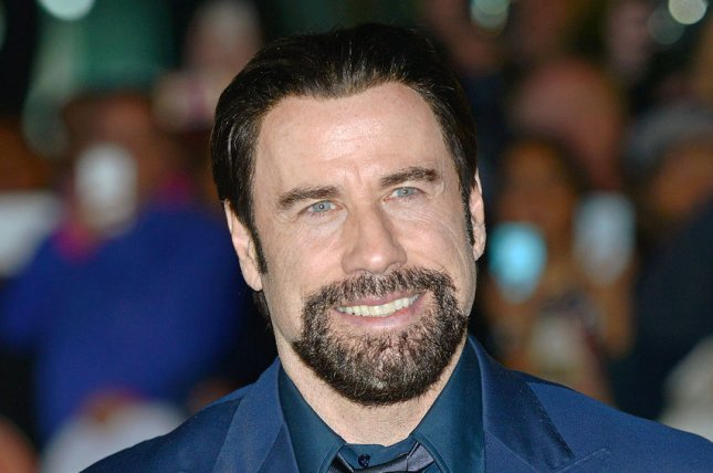 John Travolta arrives at the world premiere of 'The Forger' at Roy Thomson Hall during the Toronto International Film Festival in Toronto, Canada on September 12, 2014. UPI/Christine Chew