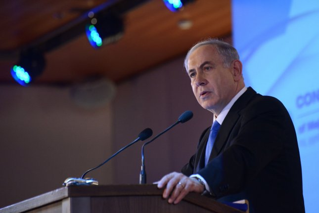Israeli Prime Minister Benjamin Netanyahu speaks Feb. 16 of his determination to appear before Congress at the Conference of Presidents of Major American Jewish Organizations in Jerusalem. Photo by Debbie Hill/UPI