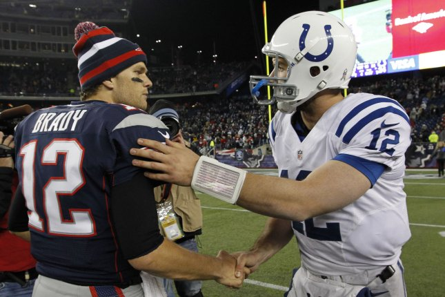 New England Patriots quarterback Tom Brady (L) shakes hands with Indianapolis Colts QB Andrew Luck (R). File photo by Matthew Healey/UPI