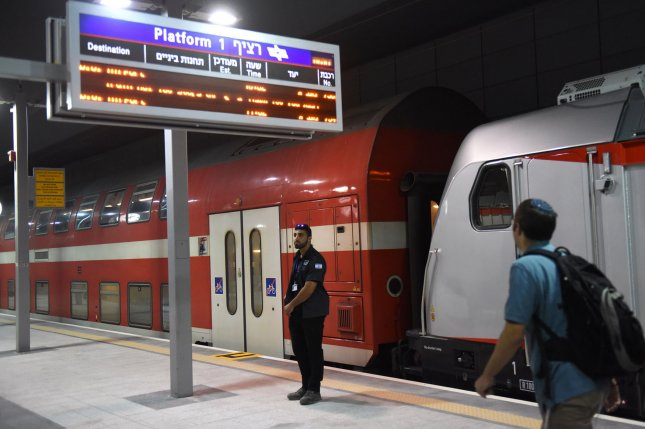 An Israeli security guard stands on train platforms in the new Yitzhak Navon train station in Jerusalem on Tuesday. A new line connecting the city to Tel Aviv opened to commuters after a 10-year delay. Photo by Debbie Hill/UPI