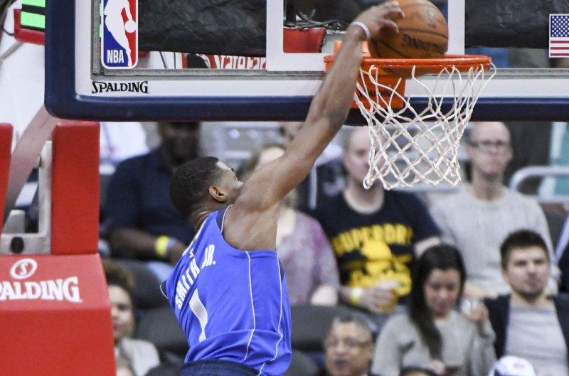Dallas Mavericks guard Dennis Smith Jr. (1) dunks the ball against the Washington Wizards. File photo by Mark Goldman/UPI