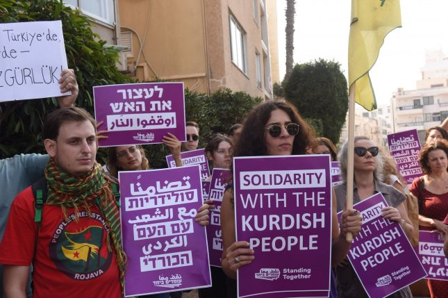Israelis protest the Turkish military campaign against the Kurdish people in Syria in front of the Turkish Embassy in Tel Aviv, Israel, on Thursday  before U.S. Secretary of State Mike Pompeo's meeting with Israeli Prime Minister Benjamin Netanyahu. Photo by Debbie Hill/UPI