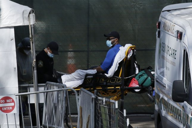 A sick patient arrives in a stretcher by ambulance in Central Park in New York City on Wednesday, April 1, 2020. Tents located along the East Meadow near Mt. Sinai Hospital are being used as an overflow medical center. Photo by John Angelillo/UPI