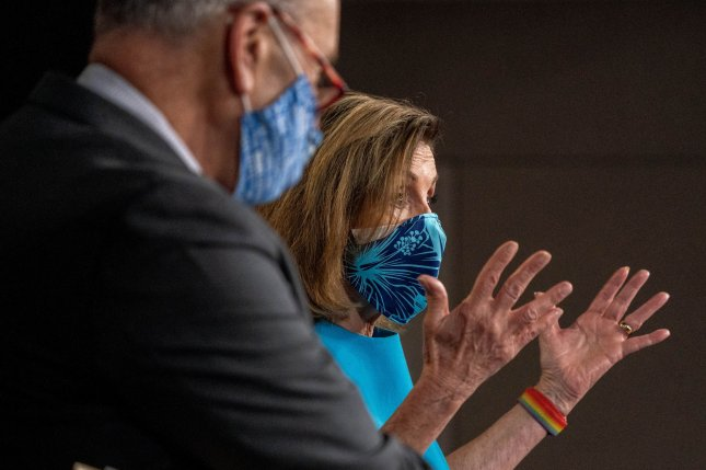 Speaker of the House Nancy Pelosi, D-Calif., and Senate Democratic leader Charles Schumer, D-N.Y., speak at a news conference on Capitol Hill on Thursday. Photo by Ken Cedeno/UPI