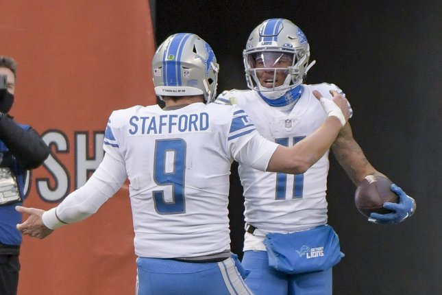 Detroit Lions quarterback Matthew Stafford (9) and wide receiver Marvin Jones (11) celebrate after a touchdown against the Chicago Bears in the fourth quarter Sunday at Soldier Field in Chicago. Photo by Mark Black/UPI
