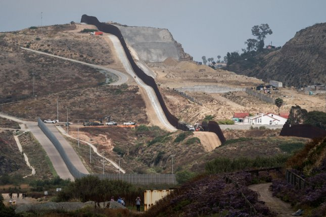 A section of the U.S. - Mexico border fence is seen at International Friendship Park in Imperial Beach, Calif., on June 10, 2019. On Friday, the Defense Department said funds the Trump administration allocated for building the border wall will be redirected to other military projects. File Photo by Kevin Dietsch/UPI