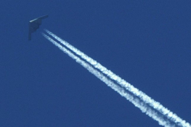 When contrails are splashed across a clear sky, their effect on the atmosphere is minimal. But new research proves contrails make an already cloudy sky more reflective. Photo by nn/bg/Bill Greenblatt/UPI