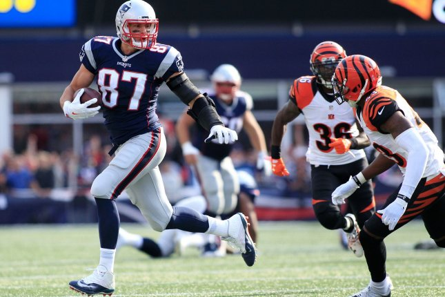 New England Patriots tight end Rob Gronkowski (87) charges down the field on a 38-yard reception in the third quarter against the Cincinnati Bengals in Foxborough, Mass., on Oct. 16. Gronk has missed three practices this week. Photo by Matthew Healey/ UPI