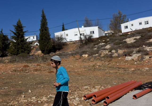 After numerous delays, demolition of the Jewish outpost at Amona, West Bank, began Monday. Forty-two displaced families will resettle in a nearby community. Photo by Debbie Hill/UPI