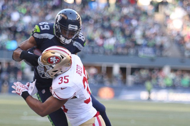 Seattle Seahawks wide receiver Doug Baldwin (89) is knocked out of bounds by San Francisco 49ers safety Eric Reid (35) near the end zone at CenturyLink Field in Seattle. File photo by Jim Bryant/UPI