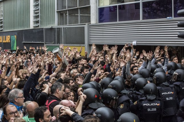 Spanish police clash with voters on Oct. 1 in Barcelona, the day of an independence referendum in Catalonia. Wednesday Spanish Prime Minister Mariano Rajoy asked for clarification on whether leaders actually declared independence. Photo by Angel Garcia/ UPI
