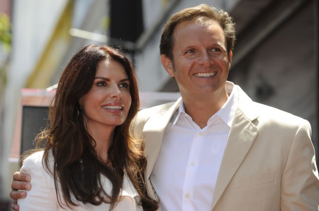 Producer Mark Burnett (R) and wife Roma Downey pose for photographers at ceremony where Burnett receives a star on the Hollywood Walk of Fame in Los Angeles on July 8, 2009. Burnett has produced reality television series like Survivor, The Apprentice, The Contender, and Are You Smarter Than a Fifth Grader.(UPI Photo/ Phil McCarten)