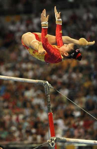 Chinese gymnast He Kexin performs her routine on the uneven bars during the Women's Uneven Bars Final at the National Indoor Stadium, August 18, 2008, at the Summer Olympics in Beijing, China. He was tied with American gymnast Nastia Liukin after their performances, and the judges awarded the gold medal to He, the silver to Liukin and China's Yang Yilin won the bronze. (UPI Photo/Mike Theiler)