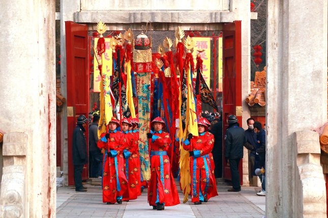 Chinese soldiers dressed as Qing Dynasty guards and as an emperor perform in a Qing Dynasty ceremony, in which emperors prayed for a good harvest and fortune, during the Spring Festival Temple Fair celebrating China's lunar new year at an ancient park in Beijing on February 19, 2015. China's most important holiday, the Spring Festival , begins on February 19 and marks the start of the Year of the Sheep, according to the Chinese zodiac. Photo by Stephen Shaver/UPI