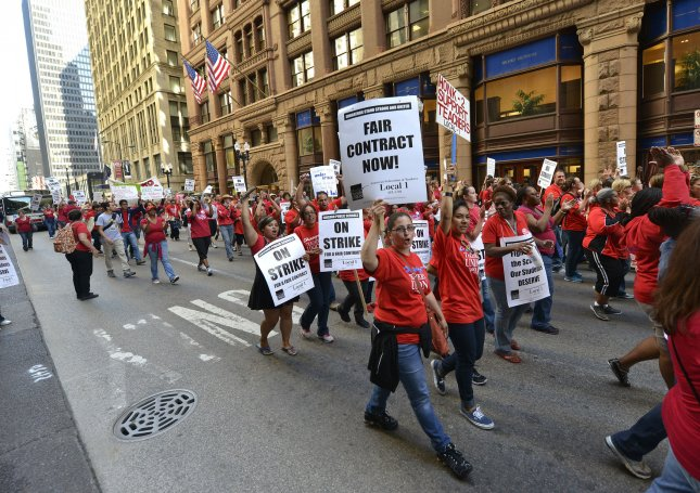 Members of the Chicago Teachers Union march through the central business district Sept. 10, 2012, in the city's first teachers' strike in a quarter-century. File Photo by Brian Kersey/UPI