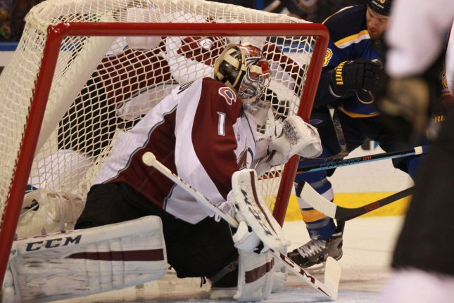 St. Louis Blues' Kyle Brodziak tips the net over on Colorado Avalanche's Semyon Varlamov of Russia in the first period at the Scottrade Center in St. Louis on December 13, 2015. Photo by Bill Greenblatt/UPI