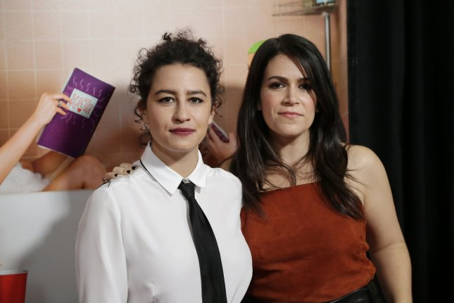 Ilana Glazer (L) and Abbi Jacobson attend the New York premiere of Sisters on December 8, 2015. The pair play Ilana Wexler and Abbi Abrams on Broad City. File Photo by John Angelillo/UPI