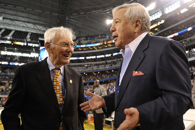 New England Patriots owner Robert Kraft (R) and Pittsburgh Steelers founding owner Dan Rooney (L) talk at Super Bowl XLV at Cowboys Stadium in Arlington, Texas on February 6, 2011. File photo by Brian Kersey/UPI