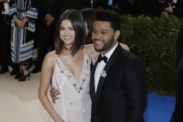 Selena Gomez Cuddles The Weeknd While He Plays Video Games