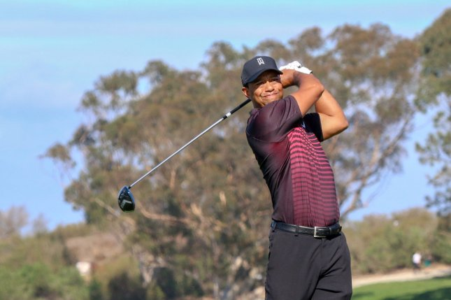 Tiger Woods drives the 4th hole during the first round of the Farmers Insurance Open at Torrey Pines on January 25 in San Diego, Calif. Photo by Howard Shen/UPI
