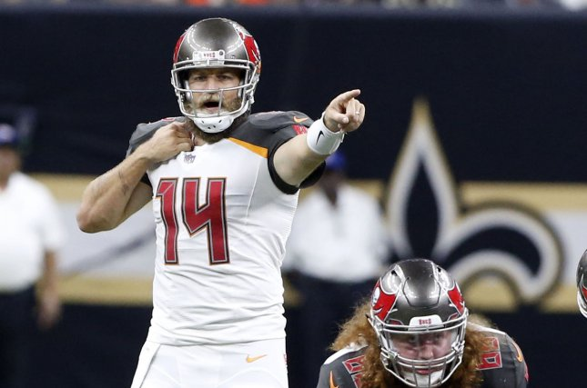 Tampa Bay Buccaneers quarterback Ryan Fitzpatrick (14) gestures before receiving the ball from Tampa Bay Buccaneers center Ryan Jensen (66) during a game with the New Orleans Saints on September 9, 2018 at the Mercedes-Benz Superdome in New Orleans. Photo by AJ Sisco/UPI