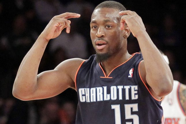 Kemba Walker and the Charlotte Hornets face the Detroit Pistons on Sunday. Photo by John Angelillo/UPI