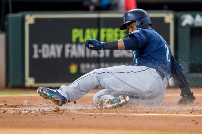 Jean Segura of the Seattle Mariners slides in safely at home plate to score a run on a wild pitch against the Houston Astros in the 1st inning on September 19 at Minute Maid Park in Houston. Photo by Trask Smith/UPI