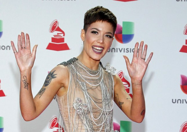 Halsey, seen here on the red carpet for the 19th annual Latin Grammy Awards on November 15, 2018, will host and be the musical guest on Saturday Night Live in February. File Photo by James Atoa/UPI