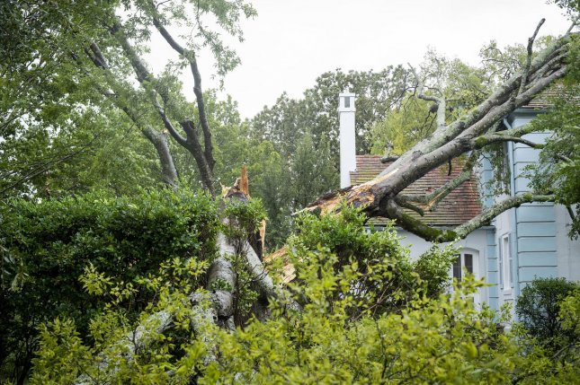 A tree lies on a house after Hurricane Laura swept through Barksdale Air Force Base in Louisiana on Thursday. Photo by SrA Lillian Miller/U.S. Air Force