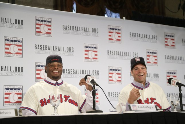 Ken Griffey Jr. and New York Mets Mike Piazza speak to the media wearing their Hall of Fame jerseys and hats at the National Baseball Hall of Fame and Museum class of 2016 press conference at the New York Athletic Club in New York City on January 7, 2016. Ken Griffey Jr. was elected to baseball's Hall of Fame on Wednesday with the highest voting percentage ever at 99 % and Mike Piazza will join him in Cooperstown this summer. Griffey Jr. chose to go into the Hall as a Seattle Marriner and Piazza chose to enter as a New York Met. Photo by John Angelillo/UPI