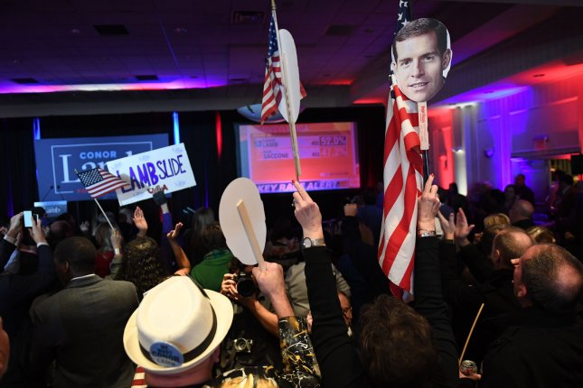 Supporters cheer for Democrat Conor Lamb in Canonsburg, Pa., on March 13 in a special election to fill a congressional seat. File Photo by Pat Benic/UPI