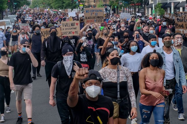 Demonstrators take to the streets to protest the police-involved killing of George Floyd in Minnesota, in Washington, D.C., on Friday. Photo by Alex Wroblewski/UPI