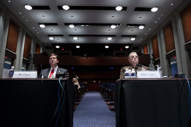 Secretary of Defense Mark Esper (L) and Joint Chiefs Chairman Gen. Mark Milley appear Thursday before the House Armed Services Committee hearing to discuss the Department of Defense in civilian law enforcement on Capitol Hill. Pool Photo by Michael Reynolds/UPI