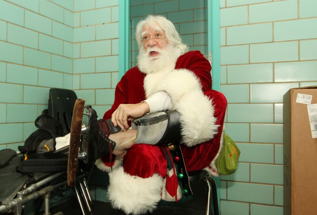 John Crowe, as Santa Claus, ties his skates as he prepares to skate with children at Steinberg Skating Rink in St. Louis, Dec. 8, 2012.UPI/Bill Greenblatt