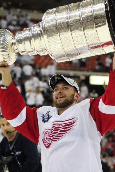 Detroit Red Wings Brain Rafalski raises the Stanley Cup and skates a victory lap after the Red Wings defeated the Pittsburgh Penguins 3-2 in the sixth game of the 2008 Stanley Cup finals at the Mellon Arena in Pittsburgh on June 4, 2008. (UPI Photo/Archie Carpenter)