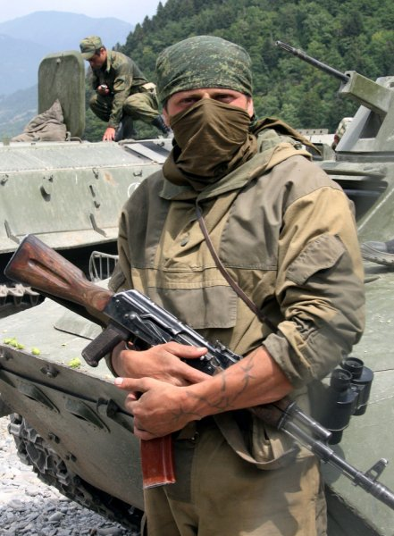 Russian soldier stands on the road to the South Ossetian capital of Tskhinvali on August 14, 2008. The shield of the road reads Republic of South Ossetia. (UPI Photo/Anatoli Zhdanov)